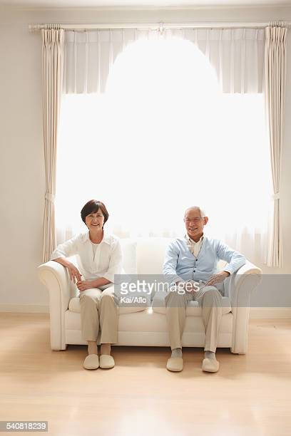 Senior adult Japanese couple on the sofa
