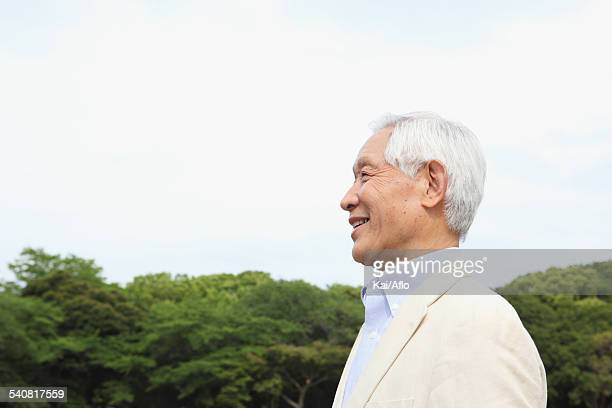 Senior adult Japanese man in a park