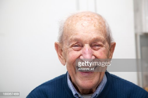 Senior adult male laughing portrait; he is 90 years old