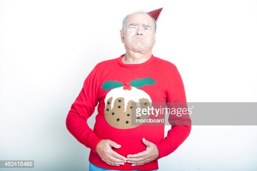 Senior Adult Man indicating that he is full up : Stock Photo