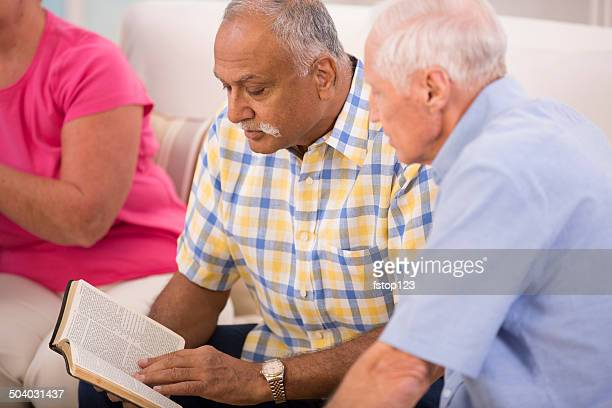 Senior adult men during bible study group.