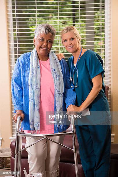 Senior adult patient with home healthcare nurse. House call.