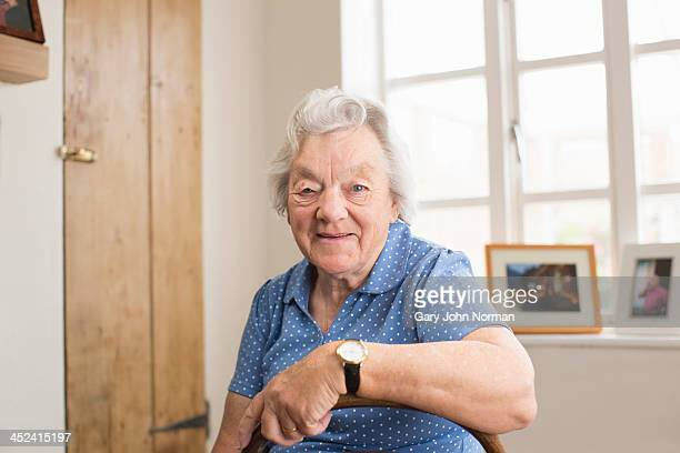 Senior adult woman sitting in room