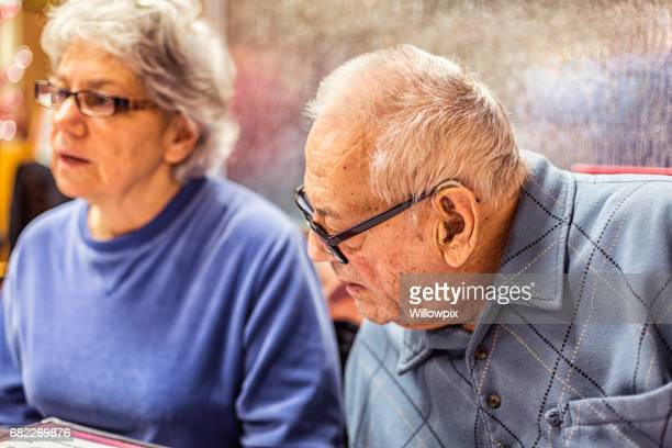 Senior Adult Woman With Elderly Father Talking at Breakfast