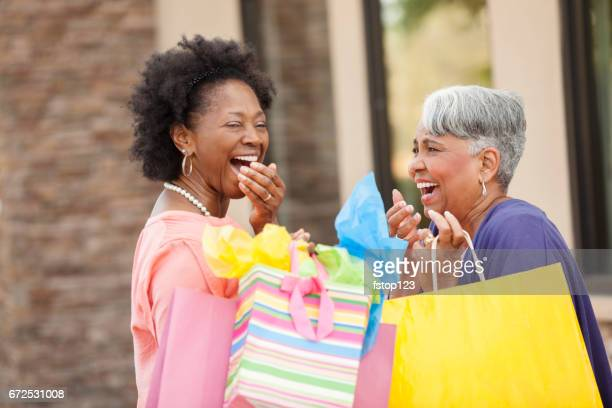 Senior adult women friends enjoy shopping day.
