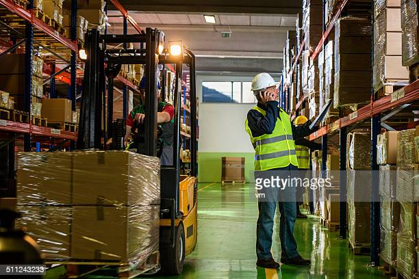 Senior Adult Worker Checking Supplies in the Warehouse