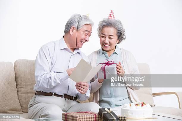 Senior adults having birthday party