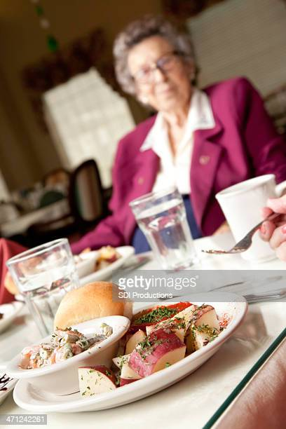 Senior Adults Having Dinner in a Dining Hall