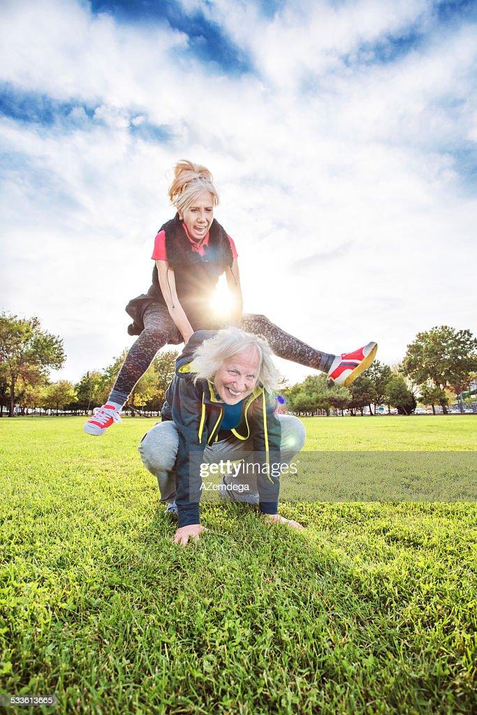 Senior adults playing leapfrog