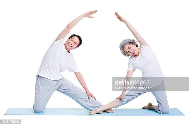 Senior adults practicing yoga