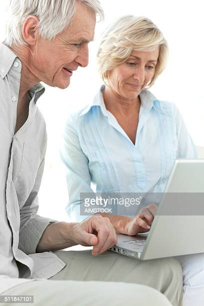 Senior adults using laptop