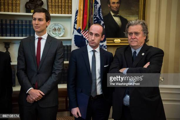 Senior Adviser Jared Kushner policy adviser Stephen Miller and chief strategist Steve Bannon watch as President Donald Trump talks about an executive...