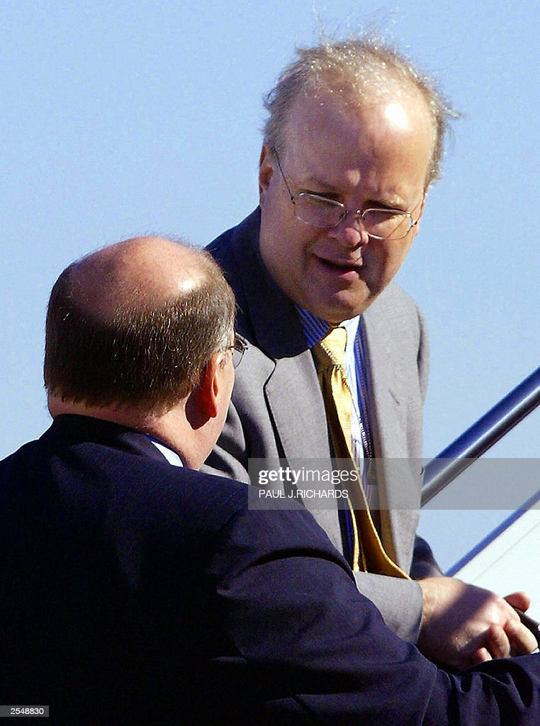 Senior Adviser to US President George W. Bush Karl Rove (top) and White House Deputy Chief of Staff Joe Hagin board Air Force One 30 September, 2003, for a trip to Chicago and Cincinnati with the president. Rove has been linked by former ambassador Joseph Wilson to the leak identifying his wife as a covert CIA agent. The US Department of Justice has opened a formal investigation into the leak. The White House has called the allegation against Rove 'ridiculous.' AFP Photo/Paul J. RICHARDS