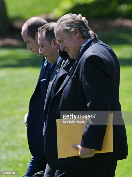 Senior Advisor Stephen Miller White House Chief of Staff Reince Priebus and White House Chief Strategist Stephen Bannon make their way to board...