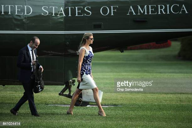 Senior Advisor to the President Stephen Miller and Ivanka Trump advisor and daughter of US President Donald Trump walk across the South Lawn after...