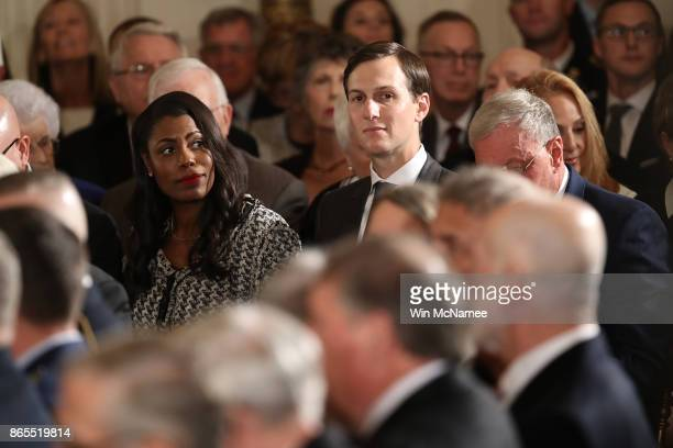 Senior advisor to US President Donald Trump Jared Kushner and Omarosa Manigault attend a ceremony awarding US Army Capt Gary Rose of Huntsville...