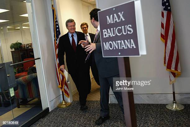 Senior advisors speak with Senate Finance Chairman Max Baucus as he leaves his office for a meeting with Democratic congressional leaders October 20...