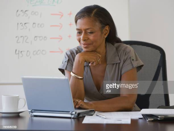 Senior African American businesswoman looking at laptop