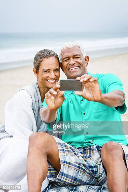 Senior African American couple having fun taking selfie