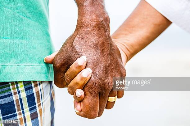 Senior African American couple holding hands