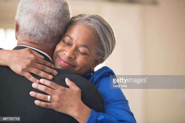 Senior African American couple hugging