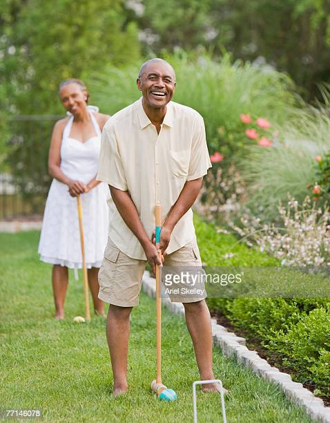 Senior African American couple playing croquet