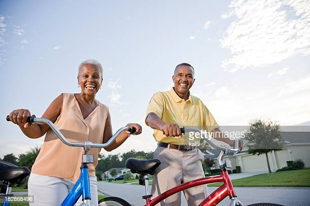 Senior African American couple riding bicycles