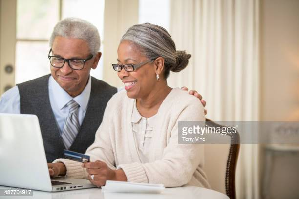 Senior African American couple shopping online