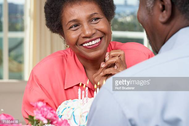 Senior African American couple with birthday cake