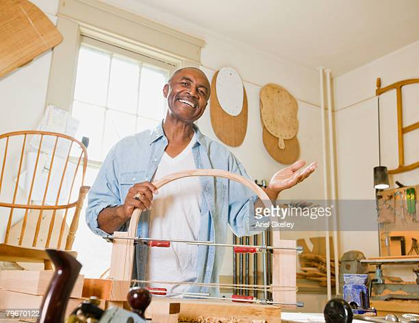 Senior African American man in woodworking shop