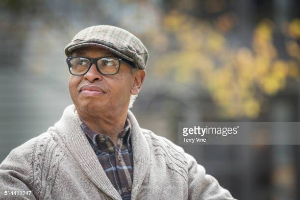 Senior African American man sitting outdoors