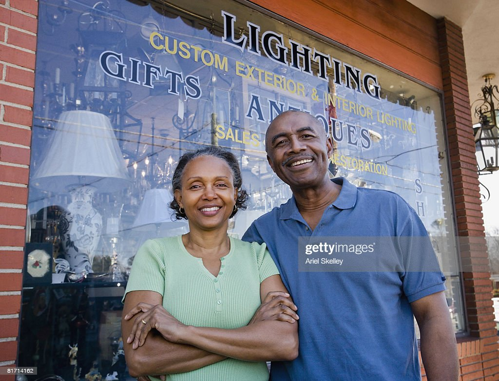 Senior African couple in front of business : Stock Photo
