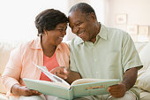 Senior African couple looking at photo album