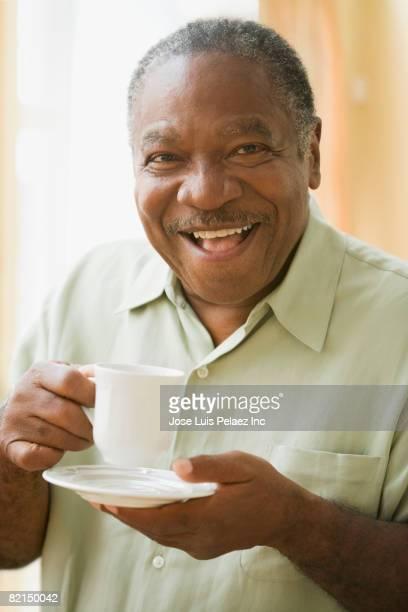 Senior African man drinking tea