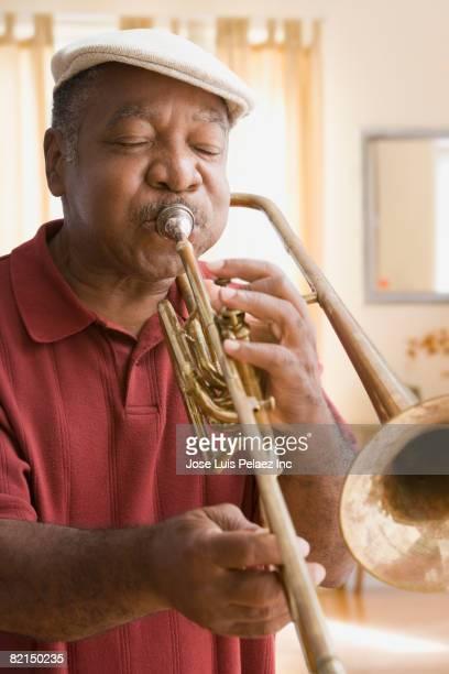 Senior African man playing trombone