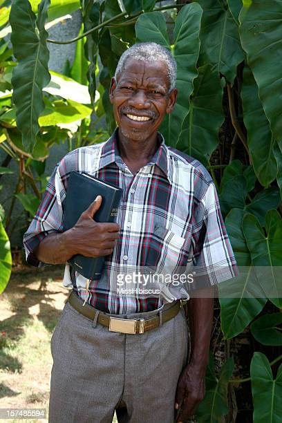 Senior African Pastor with Bible