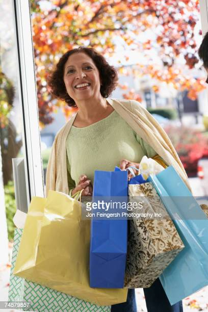 Senior African woman carrying shopping bags