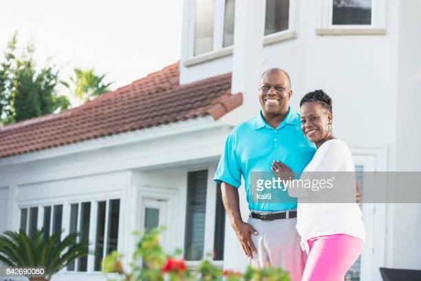 Senior African-American couple on back yard patio