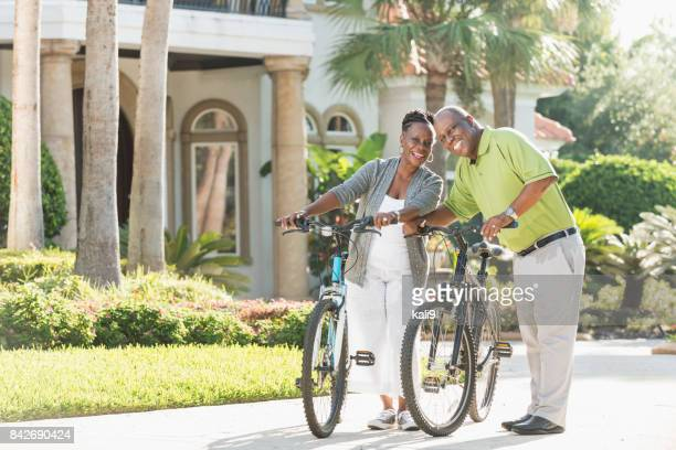 Senior African-American couple riding bicycles