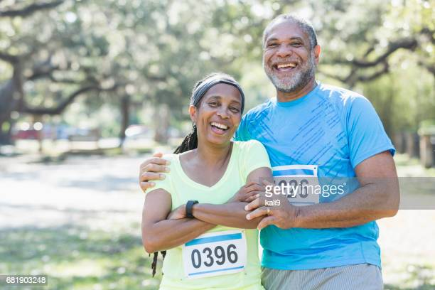 Senior African-American couple running race together