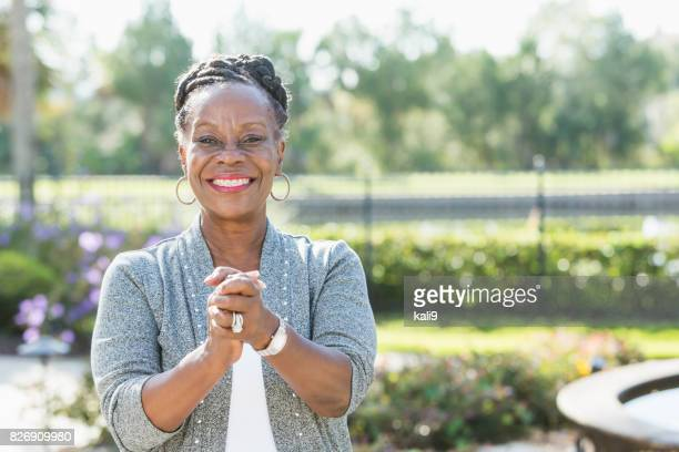 Senior African-American woman standing outdoors