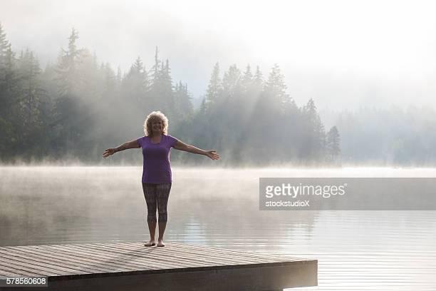 Senior aged woman practicing yoga