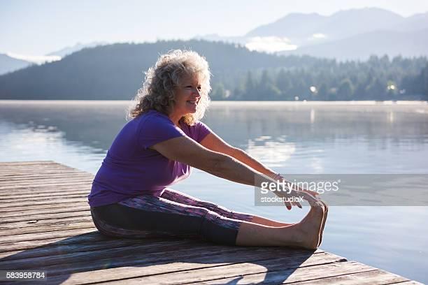 Senior aged woman stretching