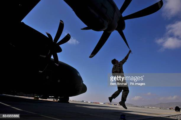 Senior Aircraftsman Technician Jay Lewis from Cascade south Wales serving with 24/30 Squadron based in RAF Lyneham checks the propellers on a C130...