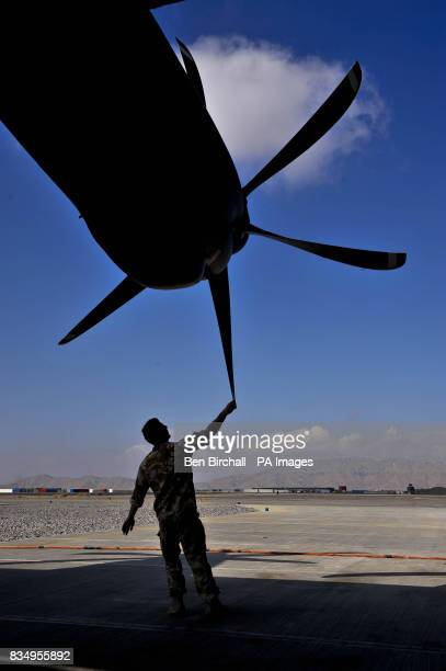 Senior Aircraftsman Technician Jay Lewis from Cascade south Wales serving with 24/30 Squadron based in RAF Lyneham checks the propellors on a C130...
