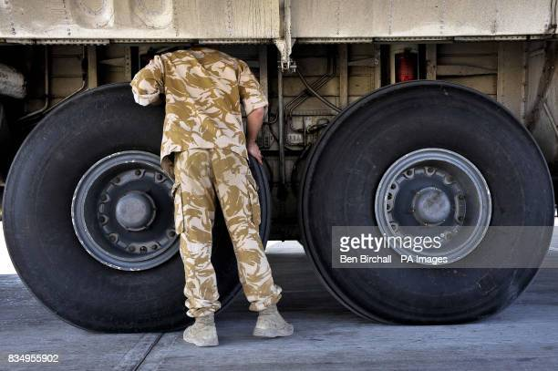 Senior Aircraftsman Technician Jay Lewis from Cascade south Wales serving with 24/30 Squadron based in RAF Lyneham checks thelanding gear bay on a on...