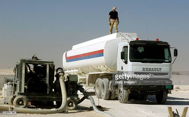 Senior Airman Jason Steel a fuels technician at the 379th Air Expeditionary Wing checks the fuel level of a hostnation contracted fuel truck December...
