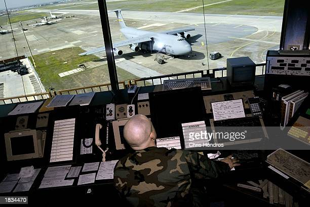 Senior Airman Miles McClure talks to pilots from the air traffic control tower March 7 2003 at Incirlik Air Force Base in Turkey Activity at Incirlik...