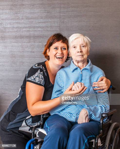 Senior and Caregiver Portrait in an Elderly Daycare Cente