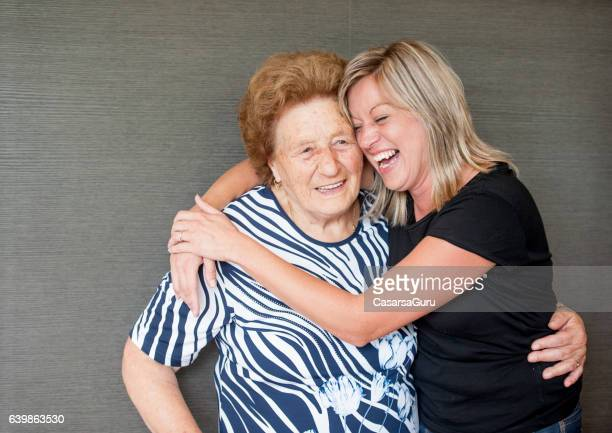 Senior and Caregiver Portrait in the Retirement Home